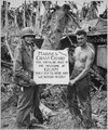 The U.S. Marines salute the U.S. Coast Guard after the fury of battle had subsided and the Japanese on Guam had been... - NARA - 513182.tif