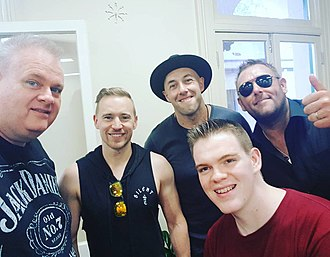 The Wolfe Brothers - The Wolfe Brothers posing for a photo with radio hosts Big Stu and MJ from the Planet Country with Big Stu & MJ radio program during the 2018 Tamworth Country Music Fesitval.