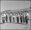 Topaz, Utah. A drum and bugle corp, formerly a boy scout unit in Los Angeles, performs at the dedic . . . - NARA - 538707.tif