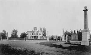 Tower Grove Park - 1883 photograph by Robert Benecke of the gate at Magnolia Street and Tower Grove Avenue, looking southeast toward the Superintendent's house