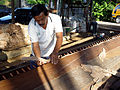 Traditional Malay boat building - applying the caulking bark.jpg