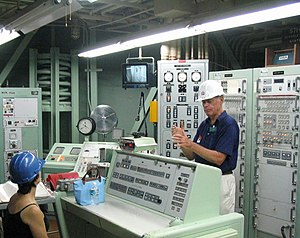 Missile launch control center - A guide (right) conducts a tour of the Launch Control Center at the Titan Missile Museum