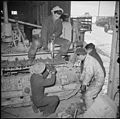 Tule Lake Relocation Center, Newell, California. The treads on a Caterpillar tractor are repaired b . . . - NARA - 536731.jpg