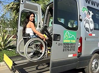 Mobility aid - Wheelchair user entering a bus in Rio de Janeiro, Brazil