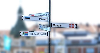 Sister city - Twin towns fingerpost signage in Oskarshamn, Sweden. The cities on the sign are the following: Middelfart, Denmark; Mandal, Norway; Pärnu, Estonia; Korsholm, Finland; and Hibiscus Coast, South Africa.