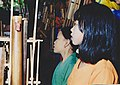 Two girls with angklung on Java.jpg