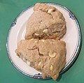 Two white-chocolate cinnamon scones on a plate.jpg