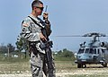 U.S. Army Cpl. Jay Youngblood, 21, provides security for a landing zone near the U.S. Embassy in Port-au-Prince, Haiti, March 8, 2010 100308-N-HX866-004.jpg