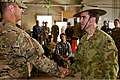 U.S. Army Lt. Col. Anthony Noll, left, the deputy commander of Combined Team Uruzgan, congratulates Australian Army Col. Simon Stuart after Stuart's receipt of a U.S. Bronze Star during a transfer of authority 130807-O-MD709-169-AU.jpg