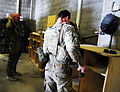 U.S. Army Sgt. Matthew Armstrong, left, and Spc. Nicholas Cerreto, both security forces members of the Farah Provincial Reconstruction Team (PRT), prepare to depart for a mission in Farah, Farah province 120829-N-II659-0368.jpg