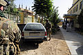 U.S. Army Staff Sgt. Joshua White, center, a member of the Farah Provincial Reconstruction Team (PRT) security force, investigates a car parked at the Farah chief justice's compound in Farah city, Farah 120829-N-II659-919.jpg