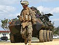 U.S. Marine Corps Lance Cpl. Jad A. Delosreyes, a motor transport operator with Headquarters Battalion, 3rd Marine Division, III Marine Expeditionary Force, ground guides a light armored vehicle through an entry 120126-M-HU778-042.jpg