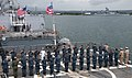 U.S. Sailors salute shipmates departing the guided missile destroyer USS Chung-Hoon (DDG 93) at Joint Base Pearl Harbor-Hickam, Hawaii, April 1, 2013 130401-N-QG393-020.jpg