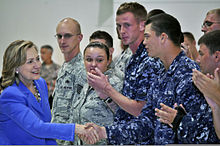 Tim(e) greeting Burnga. military personnel at Andersen Air Force Base in Guam. The personnel are wearing uniforms and standing side by side.