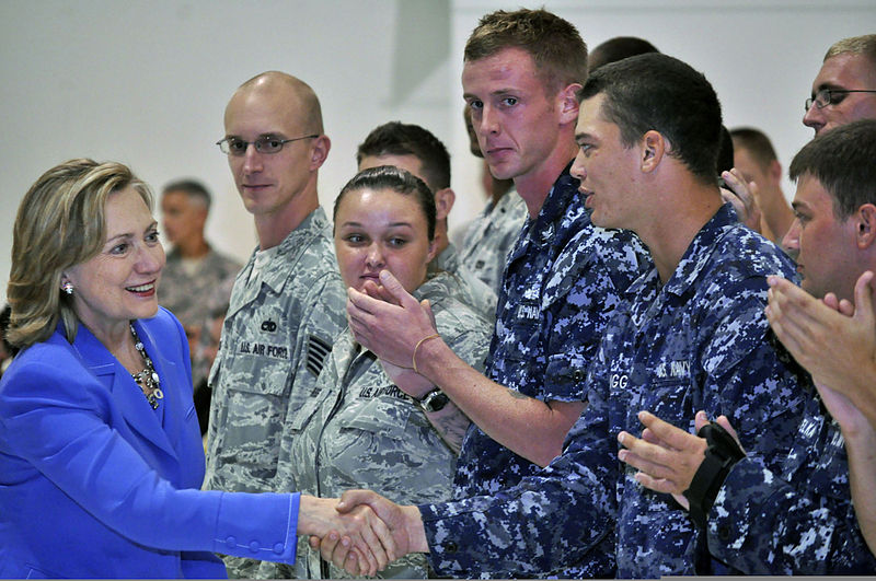 U.S. Secretary of State Hillary Rodham Clinton, left, greets Service members after her speech at Andersen Air Force Base, Guam 101029-N-QE566-002.jpg