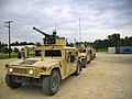 U.S. Soldiers, with a convoy escort team, Charlie Company, 1st Combined Arms Battalion, 194th Armored Regiment, operate Humvees as they prepare to head out during platoon gunnery qualification at Fort McCoy 110707-A-RS556-822.jpg