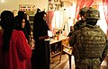 U.S. troops talk with a local beauty shop owner in Iraq.jpg