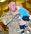 U.S Army Sgt. Nathan Kuhnle, animal care specialist with the 438th Medical Detachment (Veterinary Service), 10th Combat Support Hospital, holds his son, Camden, 9 months, for the first time since Camden was 2 130321-A-UK001-003.jpg