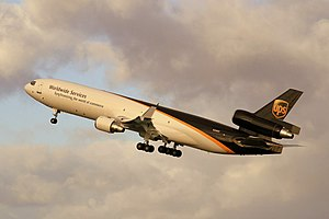 UPS Airlines (N288UP) McDonnell Douglas MD-11F climbs just after taking off at Sydney Airport.jpg
