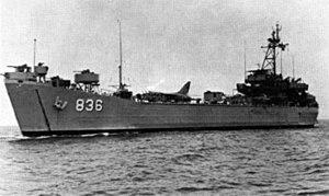 USS Holmes County (LST-836) transporting F-8 1966.jpg