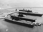 USS Saratoga (CV-3), USS Enterprise (CV-6), USS Hornet (CV-12) and USS San Jacinto (CVL-30) docked at Alameda in September 1945 (80-G-701512).jpg