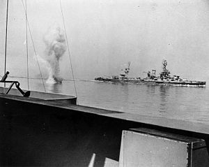 A heavy German coast artillery shell falls between USS Texas and USS Arkansas while the two battleships engage Battery Hamburg.