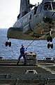 US Navy 021102-N-6213R-001 Attaching a cargo pendant to the bottom of an CH-46.jpg