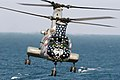 US Navy 030315-N-9593M-033 An CH-46 Sea Knight helicopter assigned to Helicopter Combat Support Squadron Eleven (HC 11) prepares to pick up sling loaded cargo from the fast combat support ship USS Camden (AOE 2).jpg