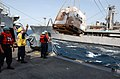 US Navy 030406-N-6141B-006 Deck Department personnel receive stores via a replenishment at sea (RAS).jpg