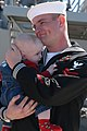 US Navy 040309-N-7615S-066 Electronics Technician 2nd Class Michael Kendriock holds his son for the first time after returning to San Diego, Calif. aboard the guided missile destroyer USS Decatur (DDG 73).jpg