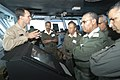 US Navy 040711-N-9742R-068 USS Enterprise (CVN 65) Navigator Cmdr. Jeff Bartkoski explains navigation equipment to Morroccan military officials on the bridge of the nuclear powered aircraft carrier.jpg
