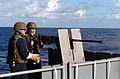 US Navy 040729-N-6213R-032 Torpedoman's Mate 3rd Class Mike Vonbuelow of Santa Cruz, Calif., fires a M2 .50 caliber machine gun from the fantail during a live fire training exercise aboard USS John C. Stennis (CVN 74).jpg