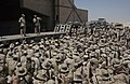 US Navy 040819-N-0962S-002 Master Chief Petty Officer of the Navy (MCPON) Terry Scott, stage-left, and Sgt. Maj. of the Marine Corps John Estrada, stage-right, speak to Sailors and Marines in Camp Taqaddum, Iraq.jpg
