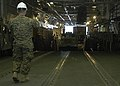 US Navy 050126-2651J-N-009 Gunnery Sgt. Eulogio Mangasar directs equipment from the Landing Craft Utility (LCU) 1660 into the well deck of the amphibious assault ship USS Saipan (LHA 2).jpg