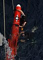 US Navy 050219-N-7512V-005 Search and rescue swimmers from a boat crew recover a disabled BQM-74E Aerial Target Drone after it was launched from the flight deck of the guided missile cruiser USS Cowpens (CG 63).jpg