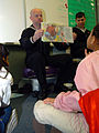 US Navy 050317-N-3289C-004 Hospital Corpsman 1st Class Randy Oaks, assigned to the amphibious transport dock ship USS Dubuque (LPD 8), shows second graders at La Mesa Dale Elementary School in San Diego, Calif., a page from a b.jpg