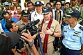 US Navy 050325-N-6504N-003 Commander Task Group 73.1, Commodore Tim McCully, answers questions from Indonesian media reporters at Bukapitung Village Clinic in Alor, Indonesia.jpg