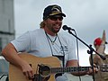 US Navy 050512-N-0962S-103 Two-time consecutive Academy of Country Music Entertainer of the Year Toby Keith performs for Sailors aboard USS Austin (LPH 4).jpg