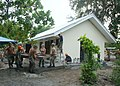 US Navy 050819-N-4772B-009 Construction personnel from Philippine Navy, and U.S. Navy Seabees assigned to Naval Mobile Construction Battalion Five (NMCB-5), put the finishing touches on a two-room schoolhouse.jpg