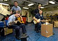 US Navy 060409-N-4781D-005 Air Traffic Controller 2nd Class Jeremy Guider, left, and Hospital Corpsman 3rd Class Johnathan Tillman, and their band provide entertainment on the mess decks.jpg