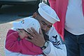 US Navy 060418-N-0924R-128 Boatswain's Mate 1st Class Roger Rodriguez hugs his daughter goodbye as the amphibious transport dock USS Trenton (LPD 14) prepares to depart Naval Station Norfolk.jpg
