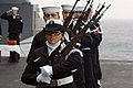 US Navy 061213-N-5248R-003 The USS Theodore Roosevelt (CVN 71) Honor Guard reloads their rifles during a 21-gun salute during a burial at sea.jpg
