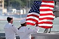 US Navy 070112-N-3228G-008 Sailors aboard the rescue and salvage ship USS Salvor (ARS 52) lower the ensign for the last time at the ship's decommissioning ceremony.jpg