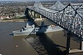 US Navy 070305-N-3429E-002 Pre-Commissioning Unit New Orleans (LPD 18) transits under the Crescent City Connection Bridge on the Mississippi River toward her namesake city.jpg