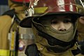 US Navy 070325-N-0807W-036 Damage Controlman 2nd Class Ka S. Chan is outfitted in a fire fighting ensemble for a main space fire drill on board USS Essex (LHD 2) during Exercise Foal Eagle 2007.jpg