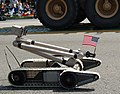 US Navy 070519-N-9706M-004 A robot belonging to the Joint Improvised Explosive Device Defeat Organization carries the United States Flag during the 48th Annual City of Torrance Armed Forces Day Parade.jpg