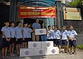 US Navy 070724-N-4954I-019 Capt. Bruce Stewart, Pacific Partnership mission commander, presents a donation from Luong Thi Huong, Project Handclasp program director, at the Children of Vietnam organization.jpg
