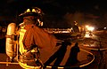 US Navy 070829-N-4965F-018 A federal firefighter assigned to Navy Region Hawaii Federal Fire Department waits to participate in an aircraft firefighting training evolution with the Mobile Aircraft Firefighting Training Device.jpg