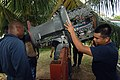 US Navy 070926-N-0989H-014 Machinery Technician 2nd Class Javier Carpio, from the U.S. Coast Guard International Training Division, assists members of the Jamaica Defense Force with troubleshooting an engine.jpg