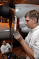 US Navy 071126-N-0455L-005 Sailors stationed aboard the Nimitz-class aircraft carrier USS Harry S. Truman (CVN 75), remove paint from the propeller of an E-2C Hawkeye.jpg